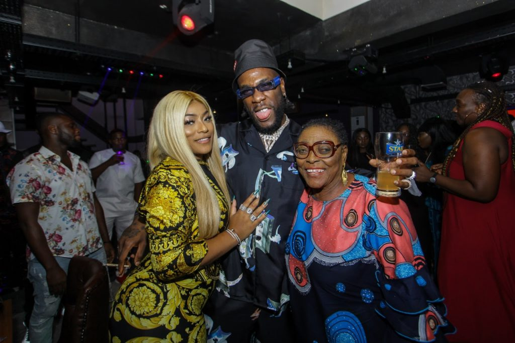 """It was a night of glitz and glam as the """"African Giant"""" Burna Boy celebrated his 28th birthday with family and friends at a private birthday dinner last night. The event was attended by his Grandparents, mother, his girl Stefflon Don, executives from Star (Nigerian Breweries), and industry friends like Dbanj, Korede Bello, Phyno, Kaffy, Olisa, Zlatan, DJ Lambo, Peedipicasso , Kaffy, Poco Lee, Toolz O, Slim case, VJ Adams, Moet, Jimmie, Efe Omoregbe, and Chopstix. The highlight of the evening was Burna Boy's grandparents cutting his birthday cake with him, as they prayed for the artiste and blessed him. His grandfather declared Burna's next award will be a grammy, and the guests responded with a resounding """"Amen!"""". The birthday dinner also served to celebrate Burna Boy's victory at the 2019 BET Awards, where he bagged the award for Best International Act 2019. A special BET award celebration will be held later tonight at Quilox nightclub for the African Giant. Find moments f"""